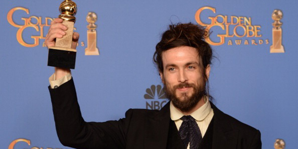 "Alex Ebert holds his trophy in the press room after winning Best Original Score - Motion Picture for ""All is Lost""  during the 71st Annual Golden Globe Awards in Beverly Hills, California, January 12, 2014.        (Photo credit should read ROBYN BECK/AFP/Getty Images)"